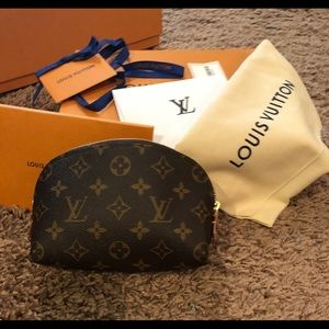 100% Authentic Louis Vuitton MNG cosmetic pouch